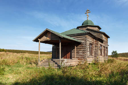 ancient architecture: KAMCHATKA, RUSSIA - SEP 19, 2015: View on ancient wooden Orthodox Church of the Assumption Church of the Dormition. The church is located in the former settlement Nizhnekamchatsk, built in 1864.