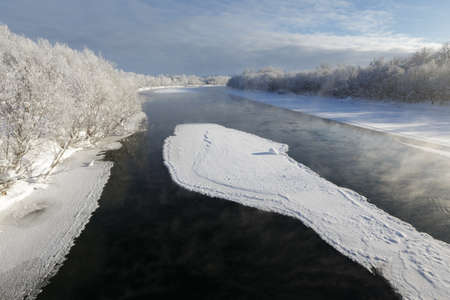 far east: Beautiful winter landscape: view of the Kamchatka River largest river on the Kamchatka Peninsula with floating ice floes on a frosty day. Eurasia, Russia, Far East, Kamchatsky Krai.
