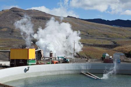 MUTNOVSKY VOLCANO, KAMCHATKA, RUSSIA - SEP 21, 2011: Pool to collect the waste thermal water on Mutnovskaya Geothermal Power Station on active Mutnovsky Volcano. Eurasia, Russian Far East, Kamchatka.