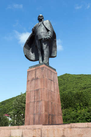 statesman: PETROPAVLOVSK-KAMCHATSKY, KAMCHATKA, RUSSIA - JULY 18, 2012: A statue monument to Vladimir Ilyich Ulyanov Lenin alias - Russian and Soviet politician and statesman, communist, revolutionary, political theorist. View of monument on sunny day.
