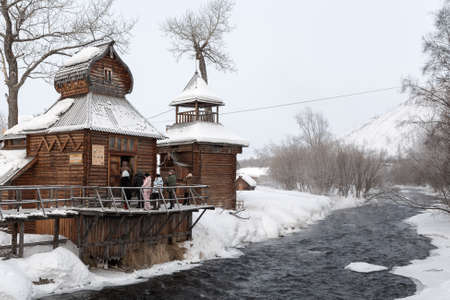 ethnographic: ESSO VILLAGE, KAMCHATKA PENINSULA, RUSSIA - MARCH 09, 2013: Winter view of the wooden building Bystrinsky Ethnographic Museum in Bystrinsky Region Kamchatka Krai on the river bank. Eurasia, Russian Far East.