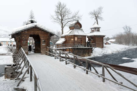 ethnographic: ESSO VILLAGE, KAMCHATA, RUSSIA - MARCH 09, 2013: Winter view of wooden buildings Bystrinsky Ethnographic Museum in Bystrinsky Region on Kamchatka Peninsula. Eurasia, Russian Far East.