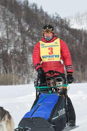 to go sledding: KAMCHATKA PENINSULA, RUSSIA - MARCH 9, 2013: Portrait Kamchatka musher Andrey Semashkin. Traditional Kamchatka extreme Dog Sled Racing Beringia. Russian Federation, Far East, Kamchatsky Krai.