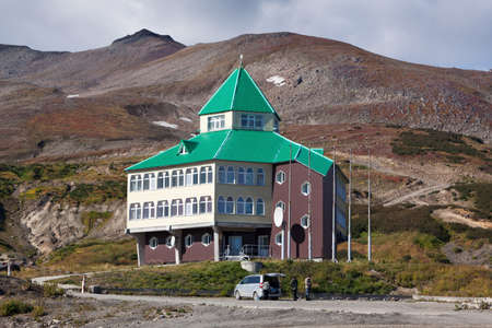 far east: MUTNOVSKY VOLCANO, KAMCHATKA PENINSULA, RUSSIA - SEP 21, 2011: Hotel building for power plant personnel, tourists and travelers, located on territory of Mutnovskaya Geothermal Power Station. Eurasia, Russian Far East, Kamchatka Region.
