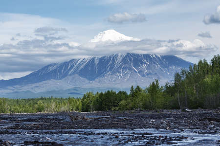volcanic landscape: Beautiful summer volcanic landscape of Kamchatka Peninsula: view on Ostry Tolbachik Volcano on a sunny day. Eurasia, Russian Far East, Kamchatsky Region, Klyuchevskaya Group of Volcanoes. Stock Photo