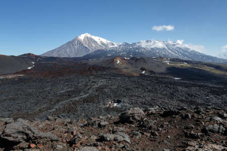 dormant: Volcanic landscape of Kamchatka Peninsula: beautiful view of Tolbachik Volcanic Massif - cone of dormant Ostry Tolbachik Volcano and cone of active Plosky Tolbachik Volcano on a clear, sunny weather. Eurasia, Russian Far East, Kamchatsky Region, Klyuchevs