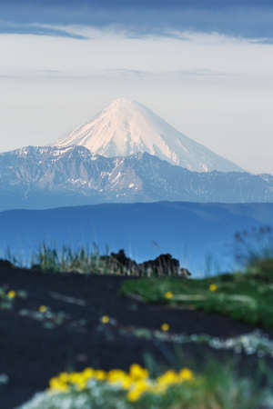 volcanic landscape: Summer volcanic landscape of Kamchatka Peninsula: view of active Kronotsky Volcano (Kronotskaya Sopka) in clear weather, sunny day. Eurasia, Russian Federation, Far East, Kamchatka Region.