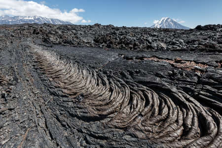 volcanic eruption: Volcanic landscape of Kamchatka Peninsula: beautiful view of lava field volcanic eruption active Plosky Tolbachik Volcano on a clear, sunny weather. Eurasia, Russian Far East, Kamchatka Region, Klyuchevskaya Group of Volcanoes. Stock Photo
