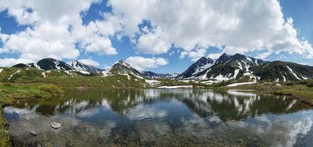 eurasia: Beautiful landscape of Kamchatka Peninsula: summer panoramic view of Mountain Range Vachkazhets, mountain lake and clouds in blue sky on sunny day. Eurasia, Russian Far East, Kamchatska Region.