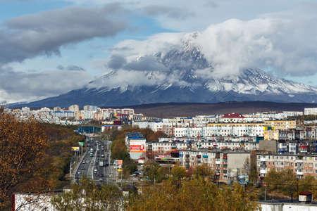 townscape: PETROPAVLOVSK-KAMCHATSKY, KAMCHATKA PENINSULA, RUSSIA - OCTOBER 11, 2016: Kamchatka autumn view of city landscape of Petropavlovsk-Kamchatsky City on background beautiful active Koryaksky Volcano. Editorial