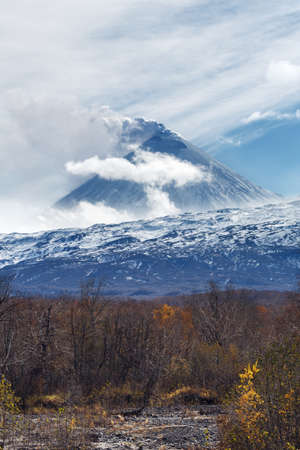volcanic eruption: Volcanic landscape of Kamchatka: active Klyuchevskaya Sopka, view of volcanic eruption - plume of gas, steam and ash from crater. Kamchatka Peninsula, Russian Far East, Klyuchevskaya Group of Volcanoes.