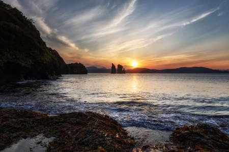 Seascape of Kamchatka Peninsula: beautiful view of sunset over Three Brothers Rocks in Avacha Bay (Pacific Ocean). Kamchatka Region, Russia, Far East, Eurasia.