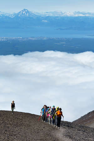 top 7: AVACHA VOLCANO, KAMCHATKA PENINSULA, RUSSIA - AUGUST 7, 2014: Hiking on Kamchatka - group of tourists and travelers climbing to top of Avachinsky Volcano on background of Avacha Bay and volcano.