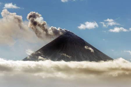 Explosive-effusive eruption of Klyuchevskaya Sopka (Klyuchevskoy Volcano) on Kamchatka Peninsula: powerful plume of gas, steam, ash from crater active volcano. Russia, Klyuchevskaya Group of Volcanoes Stock Photo