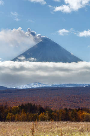volcanic eruption: Volcanic landscape of Kamchatka: explosive-effusive eruption of Klyuchevskoy Volcano: powerful plume of gas, steam, ash from crater volcano. Picturesque autumn view of volcanic eruption on sunny day.