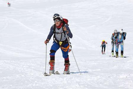 strapped: AVACHA VOLCANO, KAMCHATKA PENINSULA, RUSSIA - APRIL 21, 2012: Open Cup of Russia on Ski-Mountaineering on Kamchatka - group ski mountaineers climb on mountain on skis strapped to climbing skins.