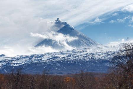 effusion: Kamchatka volcanic landscape: view of explosive-effusive eruption Klyuchevskoy Volcano (Klyuchevskaya Sopka) on a sunny weather. Russian Far East, Klyuchevskaya Group of Volcanoes. Stock Photo