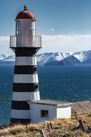 Petropavlovsky Lighthouse (founded in 1850) is located on Mayachny Cape on Kamchatka Peninsula on shore of picturesque Avacha Gulf in the Pacific Ocean, in vicinity of Petropavlovsk-Kamchatsky City.