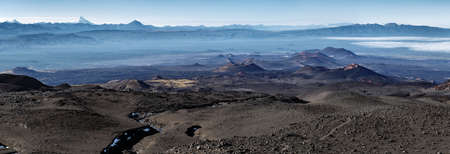 Panorama volcano landscape of Kamchatka Peninsula: series of cinder cones and lava fields of fissure eruptions Plosky Tolbachik Volcano. Russian Far East, Kamchatka, Klyuchevskaya Group of Volcanoes. Stock Photo