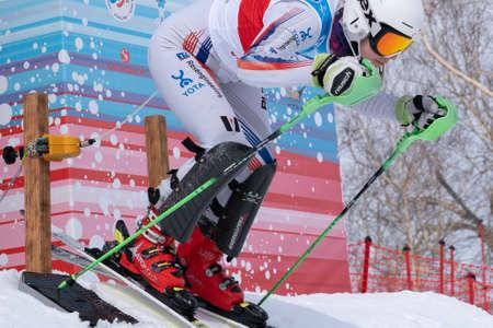 MOROZNAYA MOUNT, KAMCHATKA PENINSULA, RUSSIA - MARCH 28, 2019: International Ski Federation Championship, Russian Alpine Skiing Championship, slalom. Mountain skier Delhman Lydia (Krasnoyarsk Region). Editorial