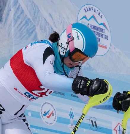 MOROZNAYA MOUNTAIN, KAMCHATKA PENINSULA, RUSSIA - MAR 28, 2019: Mountain skier Gavrish Veronika (Murmansk Region). Russian Alpine Skiing Championship, International Ski Federation Championship, slalom