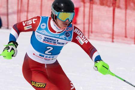 MOROZNAYA MOUNTAIN, KAMCHATKA, RUSSIA - MAR 28, 2019: Russian Alpine Skiing Cup, International Ski Federation Championship slalom. Skier Ovchinnikov Alexey (Krasnoyarsk Region) skiing down mount slope Editorial