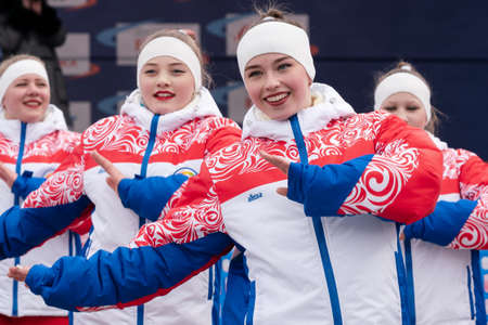 KAMCHATKA, RUSSIA - MAR 28, 2019: Expression performance of pretty girls of dance group in clothes with symbols of Russia during Russian Alpine Skiing Cup, International Ski Federation Championship.