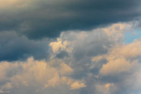 Beautiful view of natural meteorology background: stunning summer cloud scape, dramatic clouds floating across sky to weather change before rain. Atmospheric dispersion, soft focus, motion blur clouds