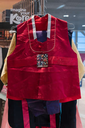 Hanbok - women traditional Korean costume vibrant colors for attire during traditional occasions: celebrations, festivals, ceremonies. Dress hanging on clothes hanger. Kamchatka, Russia - Oct 17, 2019 Redactioneel