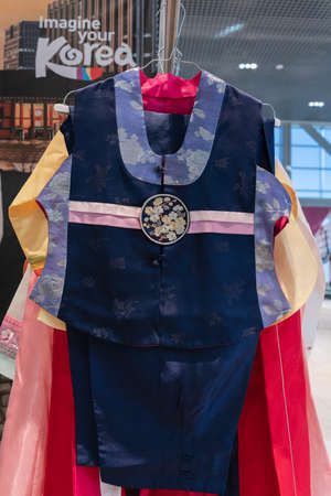 Hanbok - women traditional Korean clothes vibrant colors for attire during traditional occasions: celebrations, ceremonies, festivals. Dress hanging on clothes hanger. Kamchatka, Russia - Oct 17, 2019