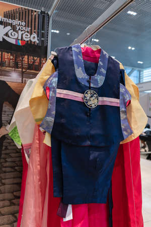 Hanbok - Korean traditional women costume vibrant color for attire during traditional occasions: festivals, celebrations, ceremonies. Dress hanging on clothes hanger. Kamchatka, Russia - Oct 17, 2019