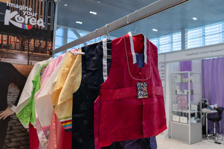 Hanbok - women traditional Korean dress vibrant colors for attire during traditional occasions: celebrations, festivals, ceremonies. Dress hanging on clothes hanger. Kamchatka, Russia - Oct 17, 2019