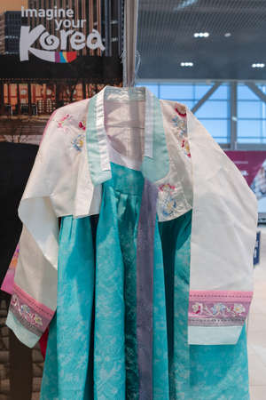 Hanbok - traditional Korean women clothes vibrant colors for attire during traditional occasions: festivals, celebrations, ceremonies. Dress hanging on clothes hanger. Kamchatka, Russia - Oct 17, 2019