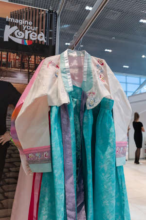 Traditional Korean women dress Hanbok vibrant color for attire during traditional occasions: celebrations, festivals and ceremonies. Clothes hanging on clothes hanger. Kamchatka, Russia - Oct 17, 2019