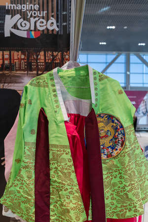 Hanbok - Korean traditional women clothes vibrant color for attire during traditional occasions: festivals, celebrations, ceremonies. Dress hanging on clothes hanger. Kamchatka, Russia - Oct 17, 2019