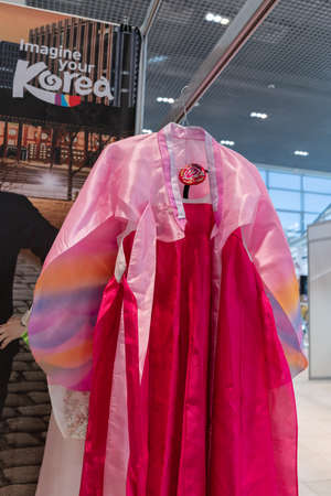 Hanbok - women traditional Korean dress vibrant colors for attire during traditional occasions: celebrations, festivals, ceremonies. Clothes hanging on clothes hanger. Kamchatka, Russia - Oct 17, 2019
