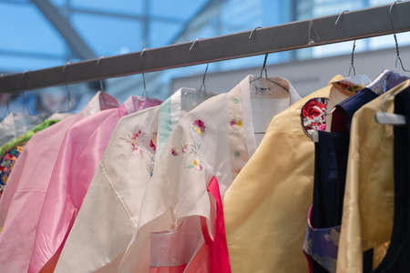 Hanbok - Korean traditional women dress vibrant colors for attire during traditional occasions: celebrations, festivals, ceremonies. Dress hanging on clothes hanger. Kamchatka, Russia - Oct 17, 2019 Redactioneel