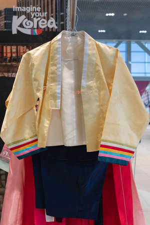 Hanbok - traditional Korean women clothes vibrant colors for attire during traditional occasions: ceremonies, festivals, celebrations. Dress hanging on clothes hanger. Kamchatka, Russia - Oct 17, 2019