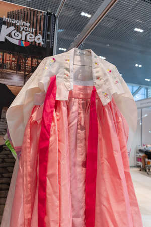 Hanbok - traditional Korean women costume vibrant colors for attire during traditional occasions: celebrations, festivals, ceremonies. Dress hanging on clothes hanger. Kamchatka, Russia - Oct 17, 2019 Redactioneel