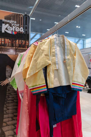 Traditional Korean women costume Hanbok vibrant color for attire during traditional occasions: celebrations, ceremonies and festivals. Dress hanging on clothes hanger. Kamchatka, Russia - Oct 17, 2019