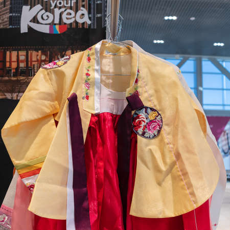 Hanbok - traditional Korean women dress vibrant colors for attire during traditional occasions as celebrations, festivals, ceremonies. Dress hanging on clothes hanger. Kamchatka, Russia - Oct 17, 2019 Redactioneel