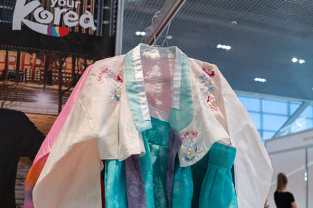 Hanbok - traditional Korean women dress vibrant colors for attire during traditional occasions: celebrations, festivals, ceremonies. Clothes hanging on clothes hanger. Kamchatka, Russia - Oct 17, 2019