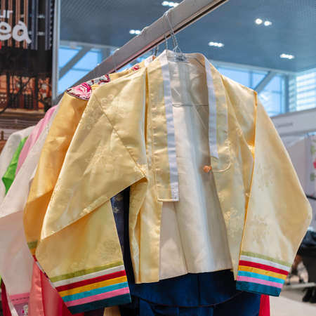 Hanbok - traditional Korean women clothes vibrant color for attire during traditional occasions: festivals, celebrations, ceremonies. Dress hanging on clothes hanger. Kamchatka, Russia - Oct 17, 2019