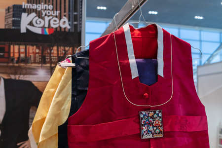 Traditional Korean women clothes Hanbok vibrant color for attire during traditional occasions: celebrations, ceremonies and festivals. Dress hanging on clothes hanger. Kamchatka, Russia - Oct 17, 2019 Redactioneel
