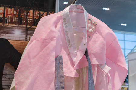 Hanbok - Korean traditional women dress vibrant colors for attire during traditional occasions: celebrations, festivals, ceremonies. Clothes hanging on clothes hanger. Kamchatka, Russia - Oct 17, 2019 Redactioneel
