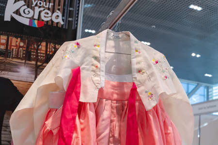 Hanbok - women traditional Korean clothes vibrant colors for attire during traditional occasions: celebrations, festivals, ceremonies. Dress hanging on clothes hanger. Kamchatka, Russia - Oct 17, 2019