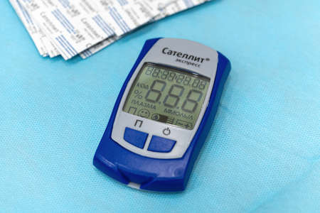 Medical device for quick test, sugar diabetes monitoring, measuring checking blood sugar in diabetes mellitus - Russian Glucometer Satellite Express. Kamchatka, Russia - October 17, 2019 Publikacyjne