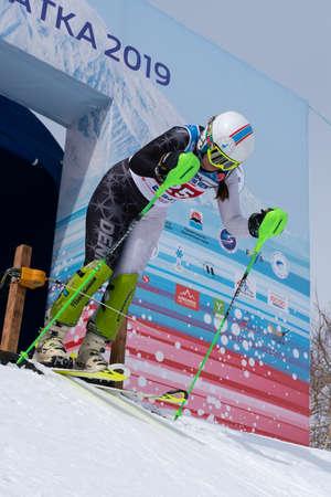 Mountain skier Kudryavtseva Ekaterina St. Petersburg at start skiing down during competition Russian Alpine Skiing Championship, slalom. Moroznaya Mount, Kamchatka Peninsula, Russia - March 28, 2019