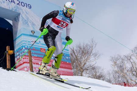 Russian Alpine Skiing Championship, slalom. Mountain skier Kudryavtseva Ekaterina St. Petersburg skiing down during competition. Moroznaya Mount, Kamchatka Peninsula, Russia - March 28, 2019