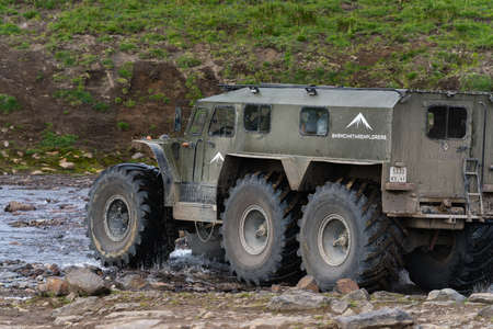 Swamp and snow extreme off-road all-terrain vehicle Predator for transporting travelers in most difficult, harsh conditions driving on mountain road. Kamchatka Peninsula, Russia - August 16, 2019